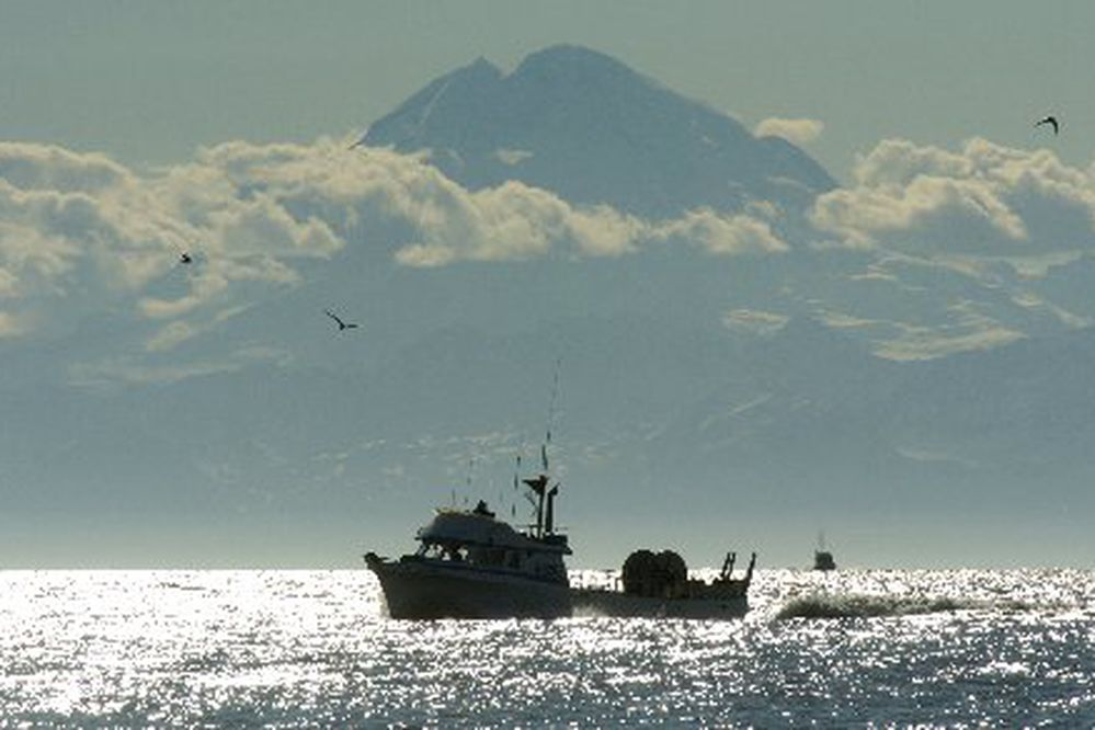 With the 10,197 foot volcano Mount Redoubt towering above in the distance, the 42-foot drift gillnetter