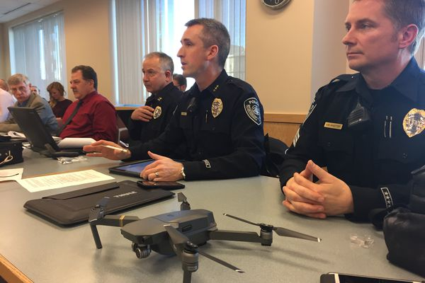 Anchorage Police Chief Justin Doll, center, discusses his agency's proposed drone program with members of the Anchorage Assembly on Wednesday, Nov. 15, 2017. A drone sits on the table before him. At right is Sgt. Mark Huelskoetter, APD's only licensed drone operator at this point. (Devin Kelly / Alaska Dispatch News)