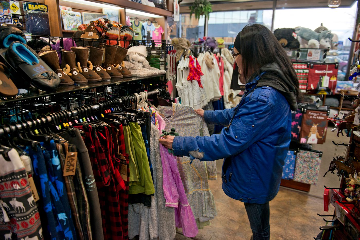 Barb Towarak shops for a kuspuk to be married in on Tuesday, December 8, 2015, two days before her wedding.