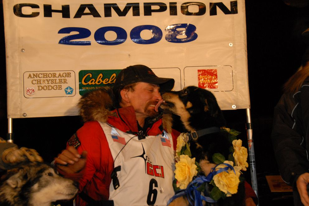 Lance Mackey after his 2008 Iditarod win with lead dogs Larry, left, and Hansom. (Bob Hallinen / ADN archive)