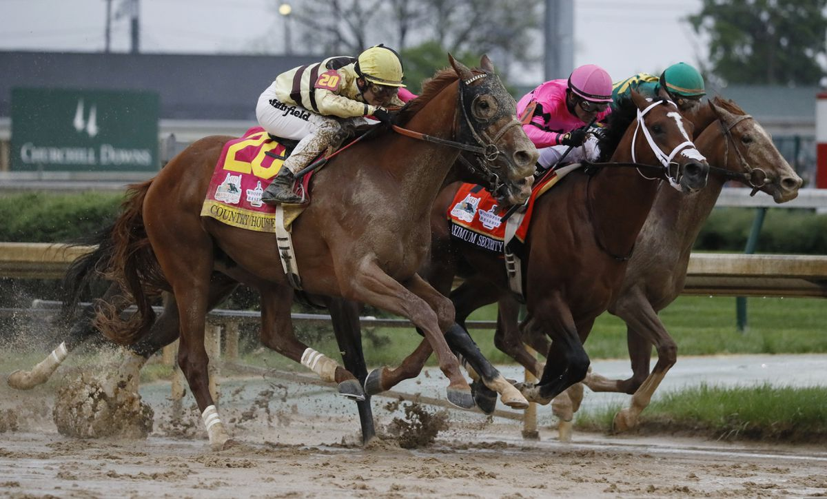 Luis Saez rides Maximum Security, center, crosses the finish line first ahead of Country House, left, and jockey Flavien Prat, during the 145th running of the Kentucky Derby horse race at Churchill Downs Saturday, May 4, 2019, in Louisville, Ky. Country House was declared the winner after Maximum Security was disqualified following a review by race stewards. (AP Photo/John Minchillo)