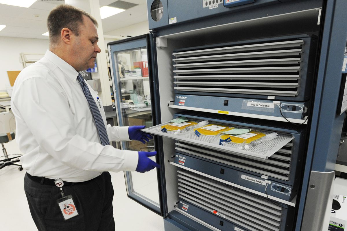 Chief Executive Officer Robert Scanlon examines a tray in the platelet agitator in the Quality Control Lab on Monday, August 8, 2016, at the Blood Bank of Alaska. (Erik Hill / ADN)