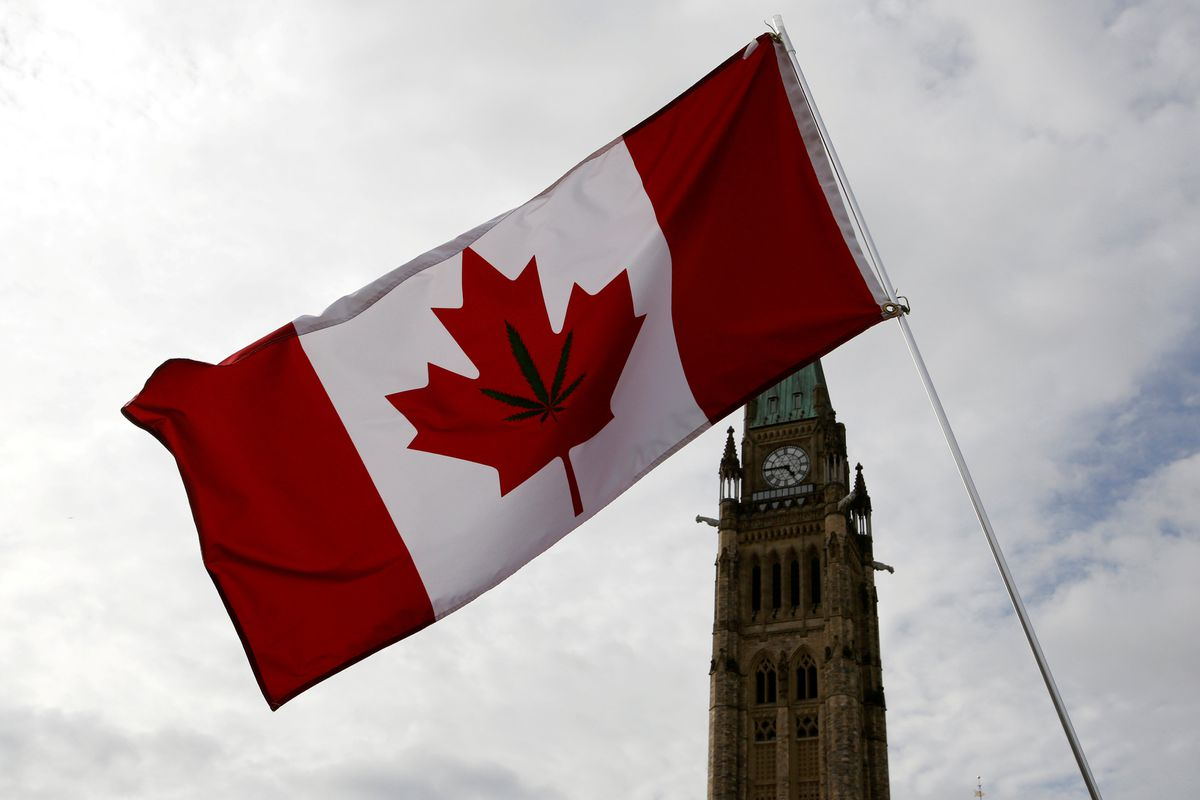 A Canadian flag with a marijuana leaf on it is seen during the annual 4/20 marijuana rally on Parliament Hill in Ottawa, April 20, 2017. REUTERS/Chris Wattie/File