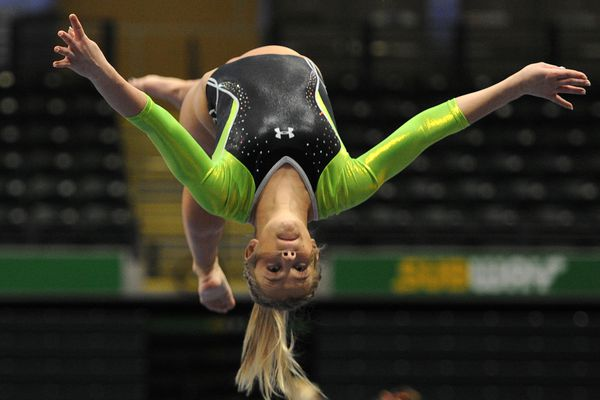 UAA sophomore Michaela Phillips competes on the beam during the Seawolves' 191.175 to 188.900 home victory over Brown at the Alaska Airlines Center on Sunday, Jan. 13, 2019. (Bill Roth/ ADN)