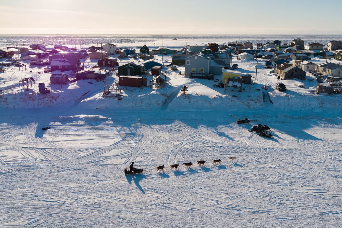 An Iditarod team mushes into Unalakleet on Sunday, March 11, 2018. (Loren Holmes / ADN)