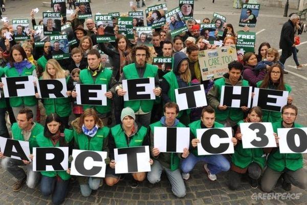 60 Greenpeace volunteers and civil society representatives gather in Ljubljana's main square, Slovenia. Oct. 7, 2013