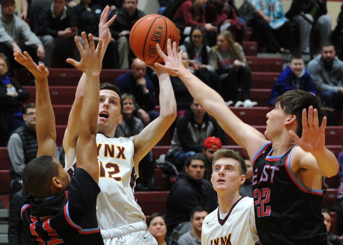 Lynx senior Kylan Osborne puts up a shot over East defenders during Dimond's 63-58 home victory over the Thunderbirds on Thursday. (Bill Roth / Alaska Dispatch News)