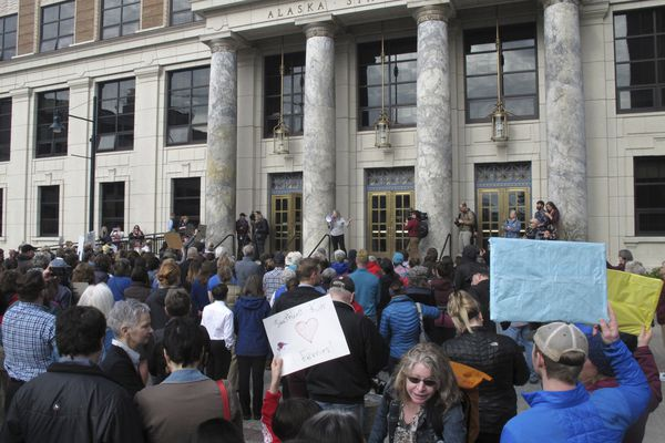 In this photo taken Wednesday, March 20, 2019, a group gathered in front of the Alaska Capitol in support of the Alaska Marine Highway System in Juneau, Alaska. Gov. Mike Dunleavy's administration has proposed big cuts as it seeks options for reshaping the ferry system, which is an important mode of transport for many coastal communities. (AP Photo/Becky Bohrer)