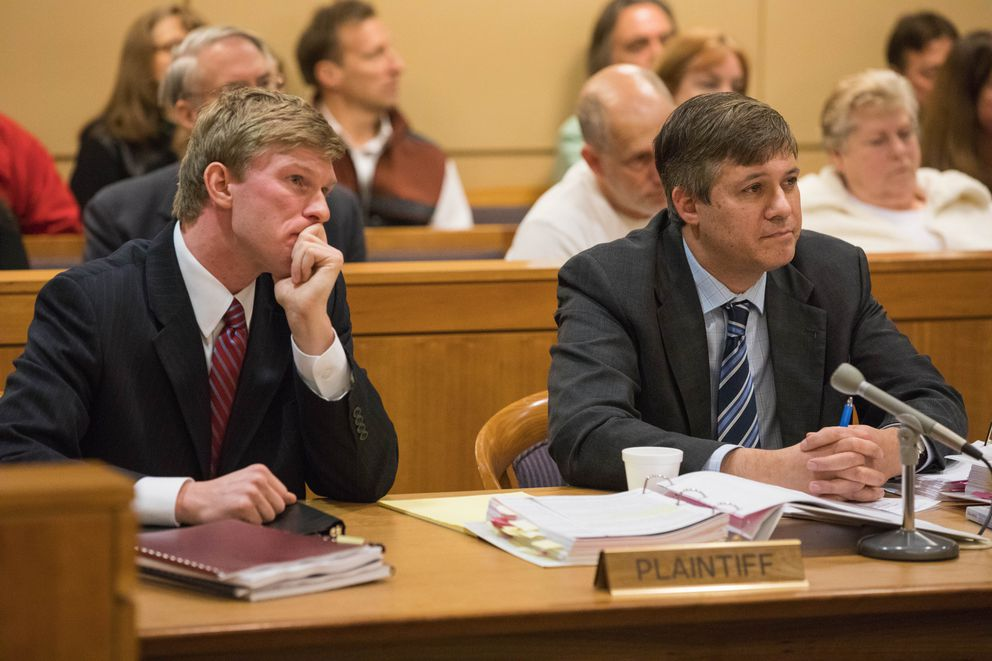 Plaintiff Sen. Bill Wielechowski, right, and attorney Andrew Erickson listen as judge William Morse rules against them in a lawsuit challenging Gov. Bill Walker's veto of half the Alaska Legislature's deposit into the Alaska Permanent Fund's dividend account, at the Nesbett Courthouse on Thursday, Nov. 17, 2016. (Loren Holmes / ADN archive)