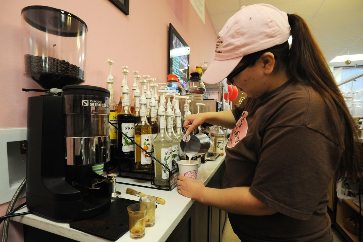 Seanne Kehm prepares an espresso drink at Eva's Cupcakery on Friday, Dec. 9, in Glenn Square. (Erik Hill / Alaska Dispatch News)