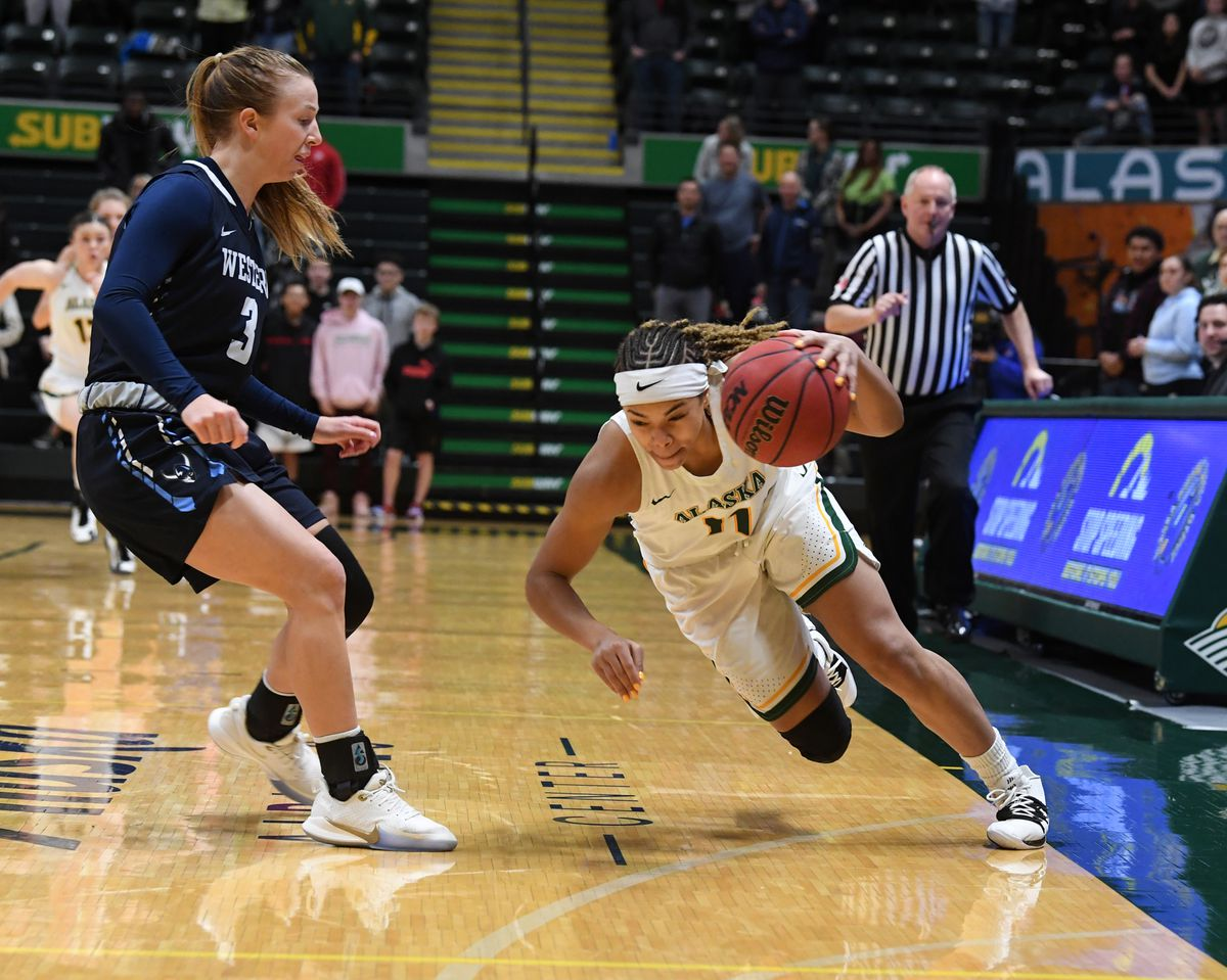 Safiyyah Yasin scoops up the loose ball for UAA in a game last month at the Alaska Airlines Center. (Photo by Bob Hallinen)