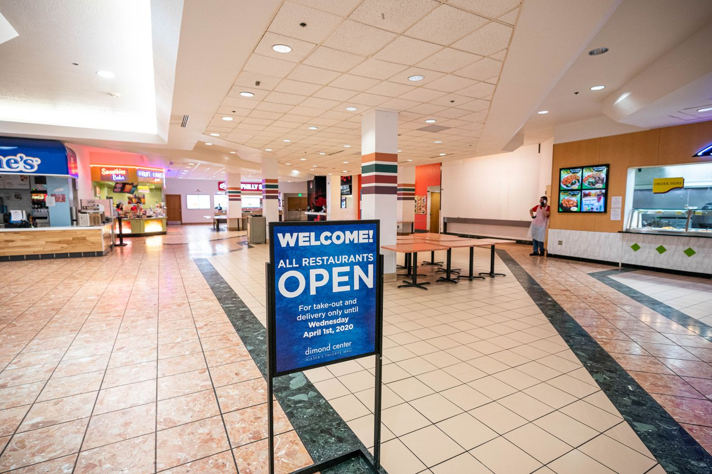 Businesses at the mostly empty Dimond Center mall food court remain open for take-out business on Wednesday, March 18, 2020 in Anchorage. (Loren Holmes / ADN)