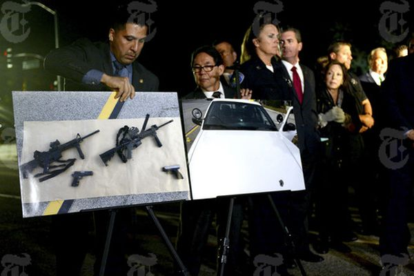 Photos of the weapons police say were used by suspects in Wednesday's mass killings in San Bernardino, Calif., displayed during Gov. Jerry Brown's news conference held outside the site, Dec. 3, 2015