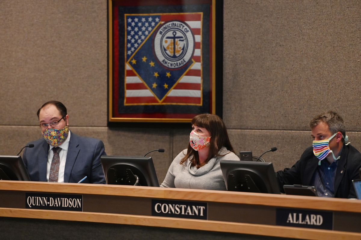 Anchorage Assembly members, from left, Chair Felix Rivera, Vice-Chair Austin Quinn-Davidson, and Christopher Constant listen to audience participation during the assembly meeting on Tuesday, June 23, 2020. (Bill Roth / ADN)
