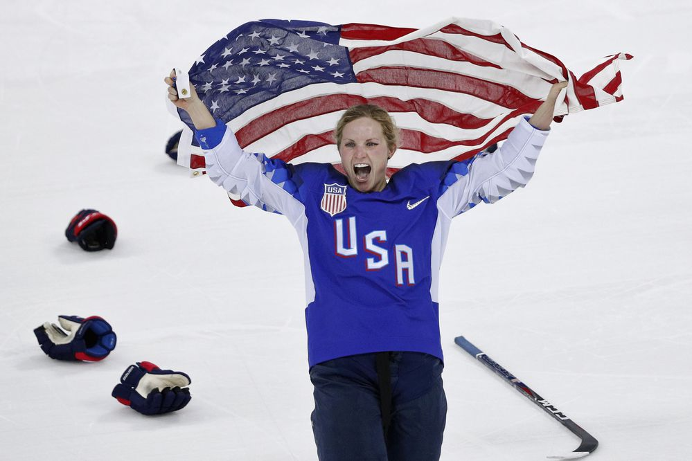 Ice Hockey - Pyeongchang 2018 Winter Olympics - Women's Gold Medal Final Match - Canada v USA - Gangneung Hockey Centre, Gangneung, South Korea - February 22, 2018 - Jocelyne Lamoureux-Davidson of the U.S. celebrates with the U.S. flag after their win. REUTERS/Brian Snyder