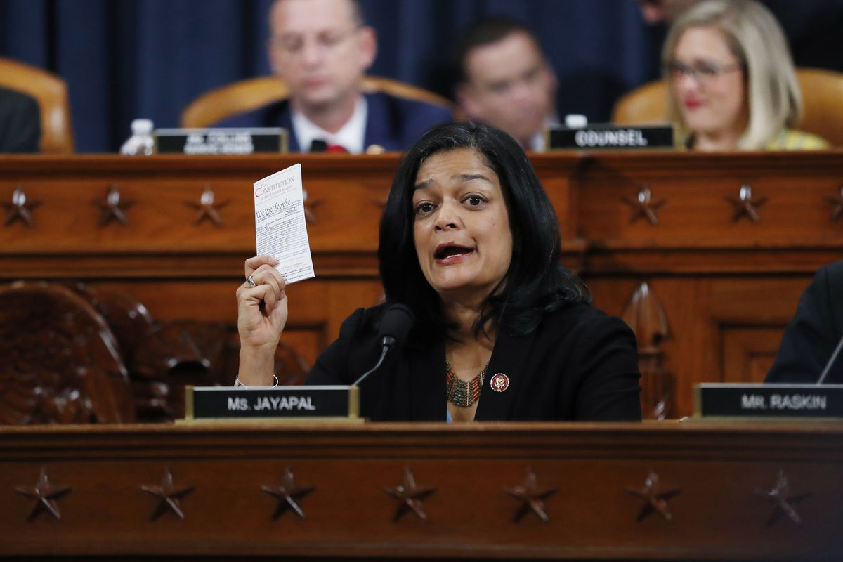 Rep. Pramila Jayapal, D-Wash., holds up a copy of the U.S. Constitution as she votes on the articles of impeachment against President Donald Trump, Friday, Dec. 13, 2019, in the House Judiciary Committee on Capitol Hill in Washington. (AP Photo/Andrew Harnik)