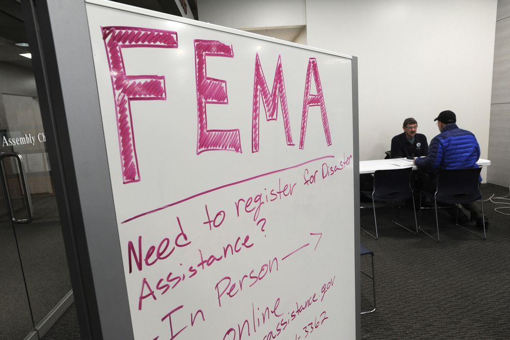 Federal Emergency Management Agency representatives assisted people seeking disaster assistance for the Nov. 30 earthquake at the Loussac Library on Sunday, Feb. 10, 2019. (Bill Roth / ADN)