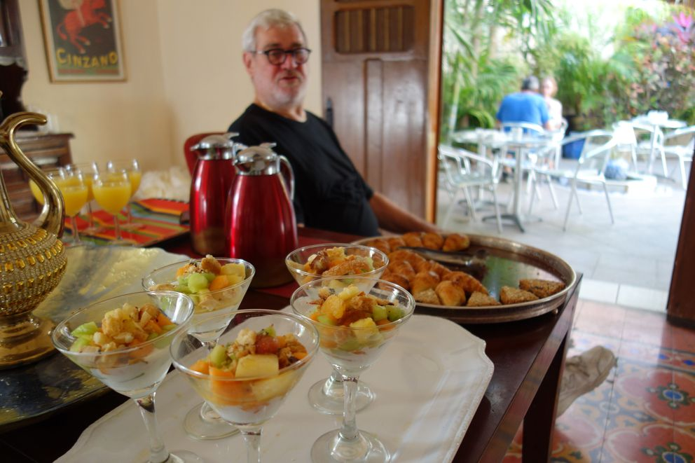 Alex Rudin, owner of Hotel Julamis in Merida, Mexico, serves up a gourmet breakfast each morning. First comes juice, then croissants (he makes 120 per week), then the fruit cup. Later, there's a custom omelet, all served in the garden. (Scott McMurren)