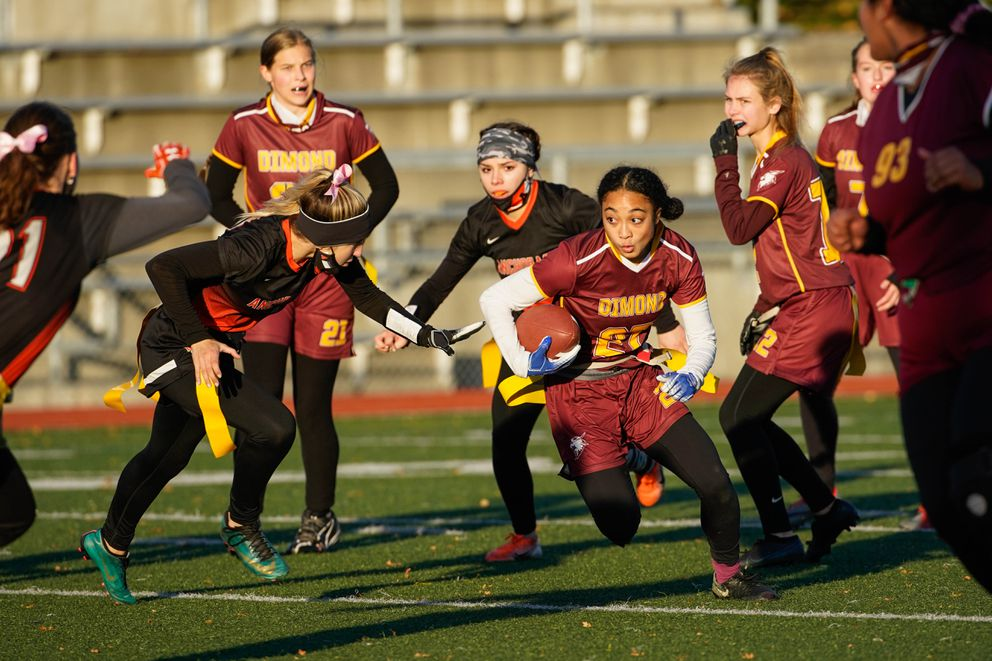 Dimond High School's Skyler Coleman runs the ball during the Cook Inlet Conference flag football championship game against West on Thursday, Oct. 22, 2020 at Dimond High School. Dimond won 22-0. (Loren Holmes / ADN)