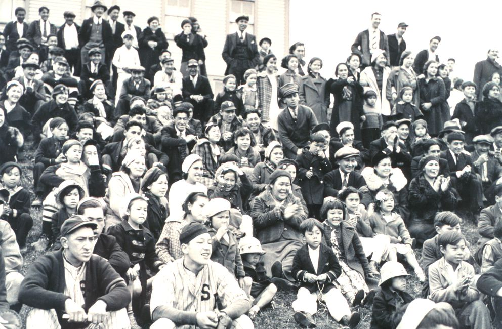 Baseball players are part of the crowd at the Fourth of July celebration at St. Paul Island in 1938. (Photo credit: National Marine Fisheries Service)
