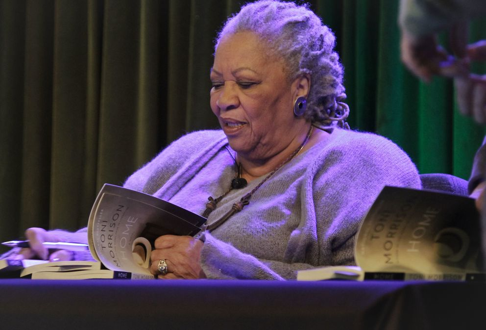 FILE - In this Feb. 27, 2013 photo, author Toni Morrison signs copies of her book 'Home ' during Google's online program series, Authors At Google, in New York. (AP Photo/Bebeto Matthews, File)