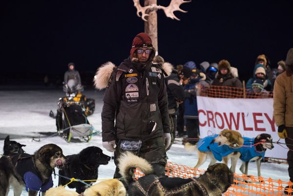 Brent Sass readies his team at the start line of the 39th annual Kuskokwim 300 Sled Dog Race in Bethel on Friday, January 19, 2018. Sass is a three-time K300 finisher and placed second behind Pete Kaiser in 2016 and 2017. (Katie Basile / KYUK)