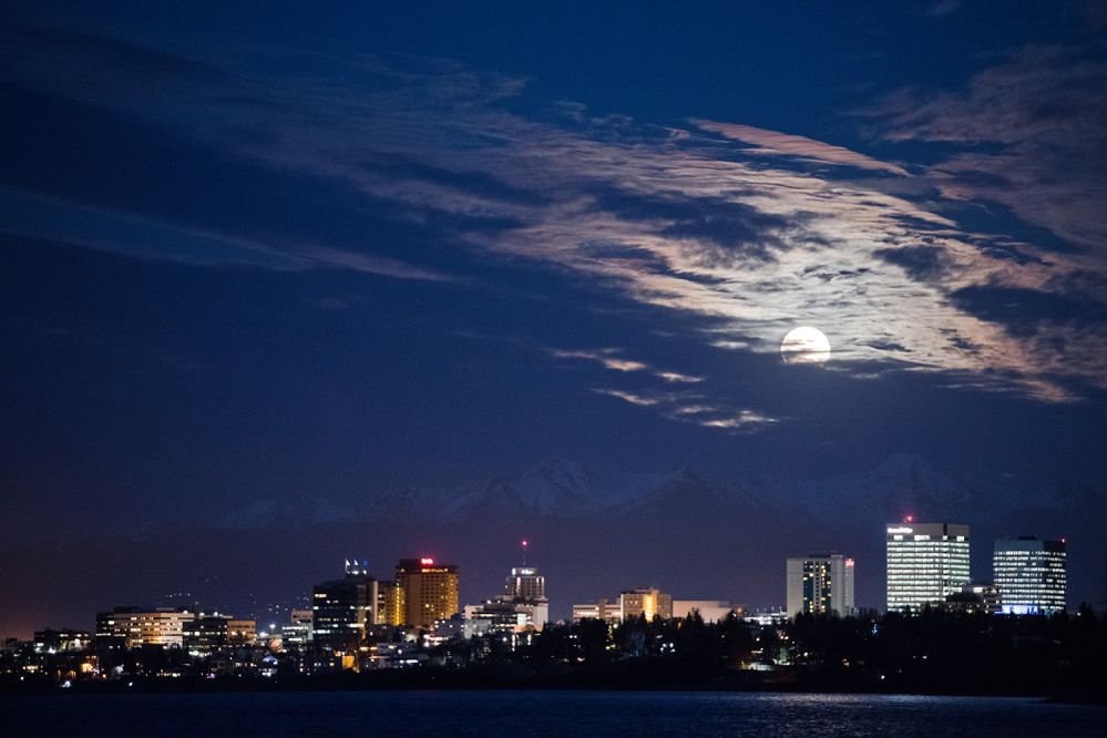 The full moon rises into view over downtown Anchorage on November 12, 2019. (Marc Lester / ADN)
