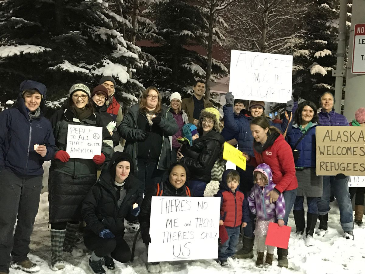 Demonstrators gather outside Ted Stevens Anchorage International Airport on Saturday in response to President Donald Trump's executive order on immigration. (Photo courtesy Michael Burke)