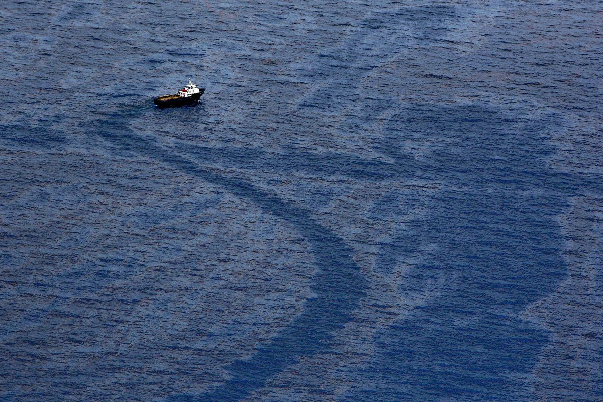 A vessel passes through oil on the surface of the water around the near the site of the Deepwater Horizon oil spill in the Gulf of Mexico near the coast of Louisiana on June 2, 2010. (Derick E. Hingle/Bloomberg)