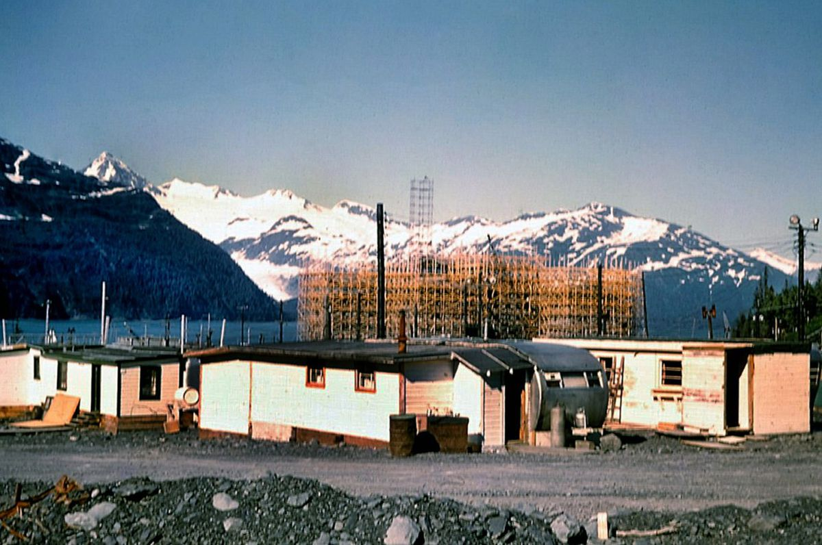 The Hodge Building, now Begich Towers, under construction in the 1950s, as seen from uphill. The trailers in the foreground were provided by the military for officers and their families prior to the opening of the building. (T.M. Spencer Collection, Hodge museum exhibit photo/PWS Museum)