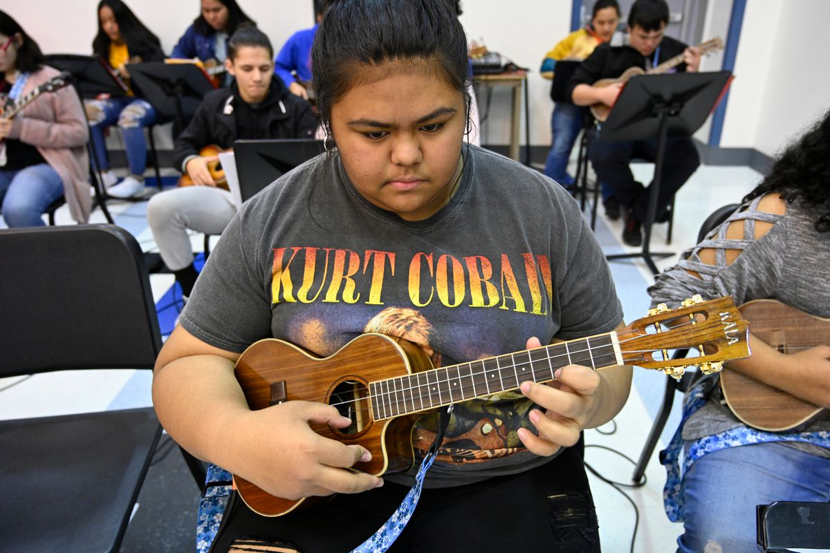 Athalia Eseroma, an East High sophomore, plays the ukulele in class on Nov. 20. (Marc Lester / ADN)