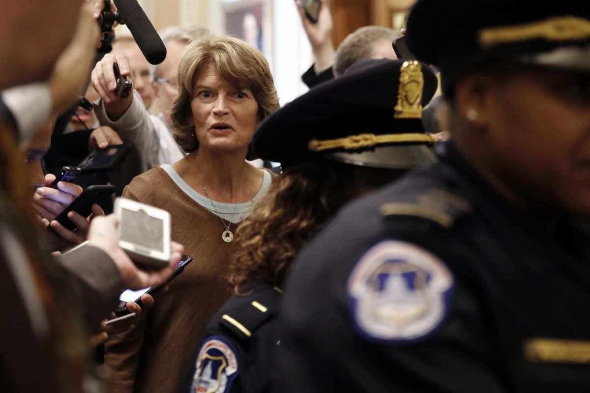 Sen. Lisa Murkowski, R-Alaska, surrounded by reporters asking questions about Supreme Court nominee Brett Kavanaugh, Friday Sept. 28, 2018, on Capitol Hill in Washington. (AP Photo/Jacquelyn Martin)