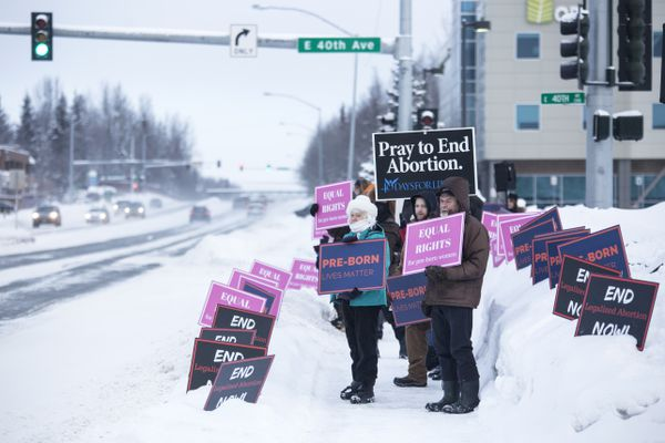 Anti-abortion advocates gather in an effort to remove federal funding from Planned Parenthood on Saturday, Feb. 11, 2017, on the corner of Lake Otis Parkway and East 40th Avenue in Anchorage. Rallies are being held at Planned Parenthood locations throughout the United States. (Rugile Kaladyte / Alaska Dispatch News)