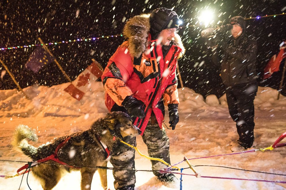 Mitch Seavey checks his dog team before leaving the Takotna checkpoint on Wednesday. (Loren Holmes / ADN)