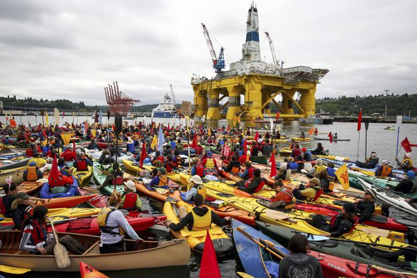 In this May 16 file photo, activists opposed to Royal Dutch Shell's plans to drill for oil in the Arctic Ocean prepare their kayaks for the