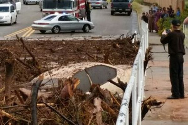 A vehicle rests in debris after a flash flood Monday in Hildale, Utah. Authorities say multiple people are dead and others missing after a flash flood ripped through the town on the Utah-Arizona border Monday night.