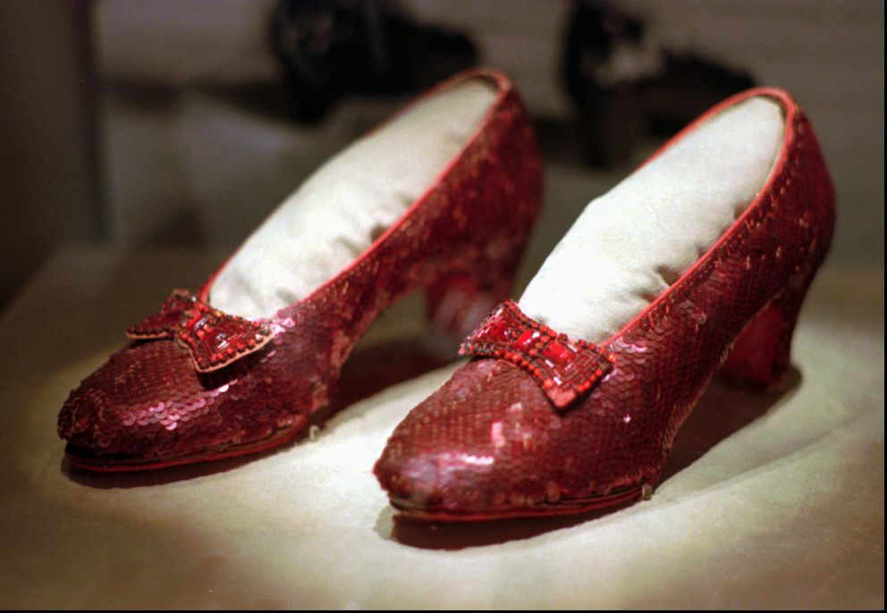 This April 10, 1996, file photo shows one of the pairs of ruby slippers worn by Judy Garland in the 1939 film 'The Wizard of Oz ' on display during a media tour of the 'America's Smithsonian ' traveling exhibition in Kansas City, Mo. (AP Photo/Ed Zurga, File)