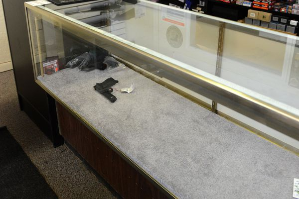 A display case is nearly empty in Anchorage, Alaska on Friday, Sept. 8, 2017 after thieves stole the case full of handguns. Anchorage police are searching for two men who they say stole 36 firearms from EDC Alaska, a local knife and gun shop on East Northern Lights Boulevard. (Bob Hallinen / Alaska Dispatch News)