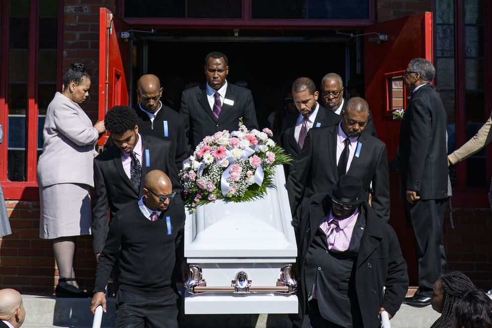 Pallbearers carry Vickie Lee Jones' casket out of the Church of the Living God in Louisville, Kentucky, on Nov. 3. MUST CREDIT: Photo for The Washington Post by William DeShaze