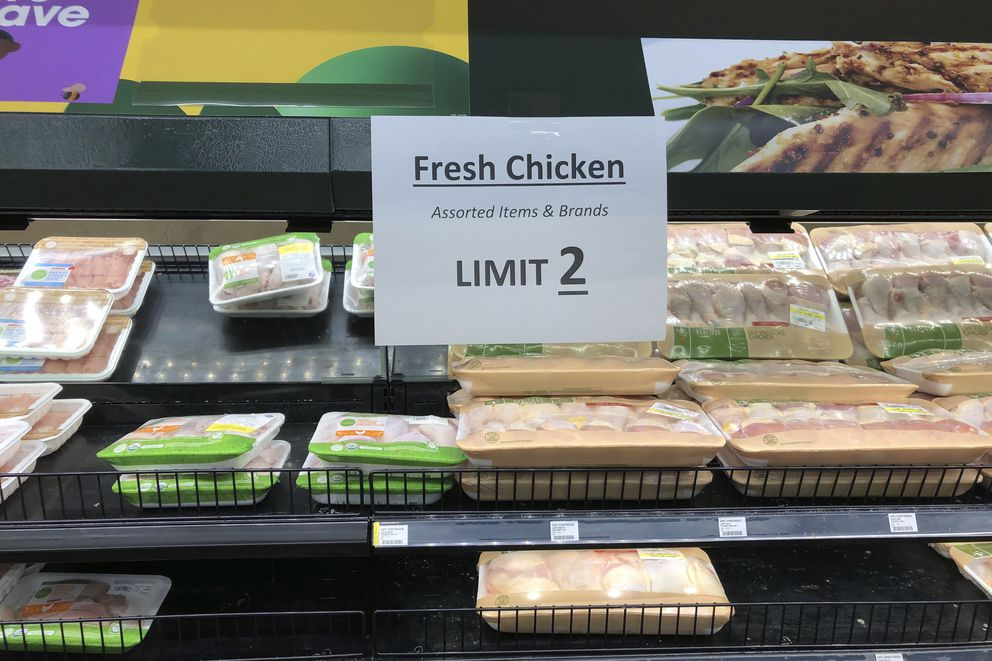 A sign at a Kroger store in Atlanta limits shoppers to two packages of chicken on Tuesday, May 5, 2020. Kroger is limiting meat purchases, like a number of other grocery retailers, due to supply concerns amid the COVID-19 pandemic.(AP Photo/Jeff Amy)