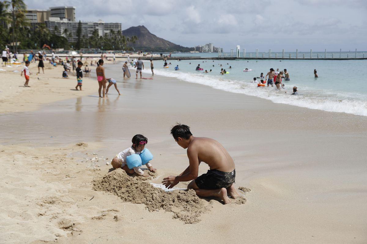 Tourists on Waikiki Beach in Honolulu. (AP archive/Marco Garcia)