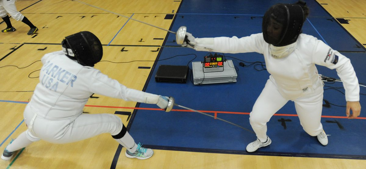 South High senior Marielle Luke, right, bouts with coach Jacquie Parker during an Anchorage Fencing Club practice Tuesday at Pacific Northern Academy. (Bill Roth / Alaska Dispatch News)