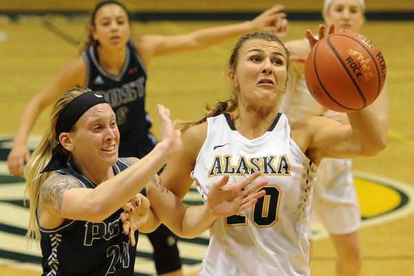 Post University forward Nicole Sheloski battles UAA center Hannah Wandersee for a rebound during the Seawolves' 99-32 victory over the Eagles at the Alaska Airlines Center on Thursday evening, Nov. 17, 2016. (Bill Roth / Alaska Dispatch News)
