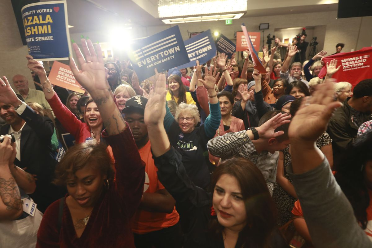 Democratic supporters cheer their candidates at a Democratic Party event in Richmond, Va., Tuesday, Nov. 5, 2019. All seats in the Virginia House of Delegates and state Senate are up for election. (AP Photo/Steve Helber)