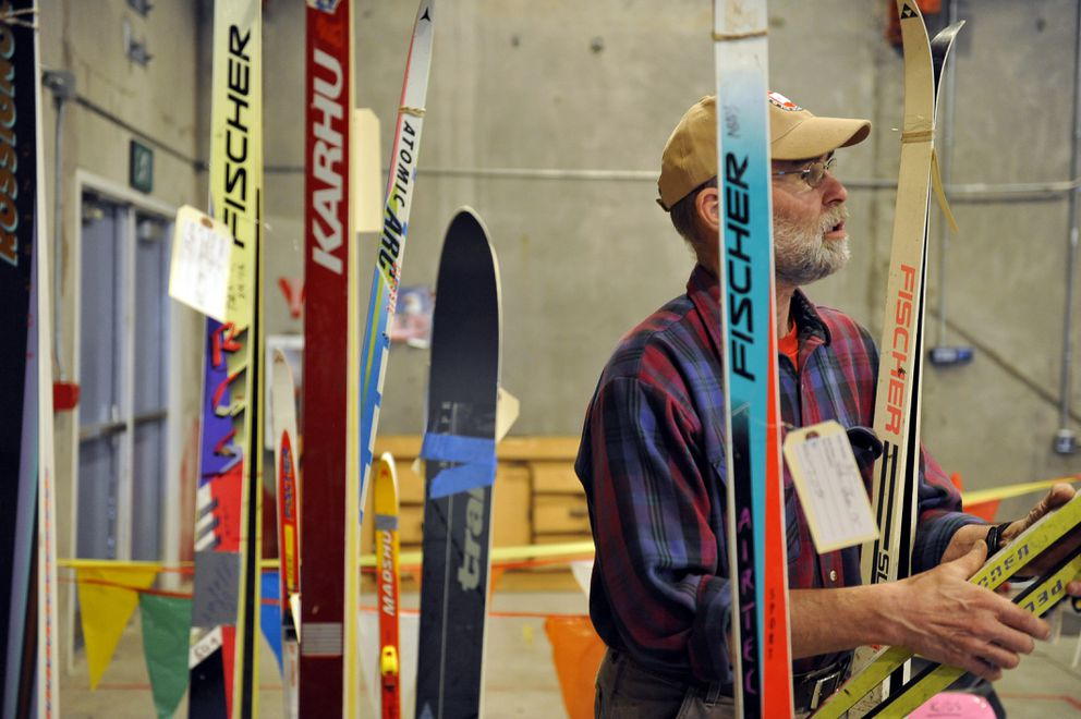 John Whitney checks out a pair of classic skis at the Nordic Ski Association of Anchorage's Ski Swap at the Kincaid Bunker on Saturday, November 5, 2011. The event was followed by a potluck dinner and live music at the Kincaid Chalet. (Marc Lester / ADN)
