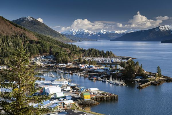 """A view of downtown Wrangell, Alaska, April 2018. The former timber town John Muir described as """"a rough place,"""" is one of the stops on a D.I.Y. tour of Alaska's Inside Passage. (Christopher Miller/The New York Times)"""