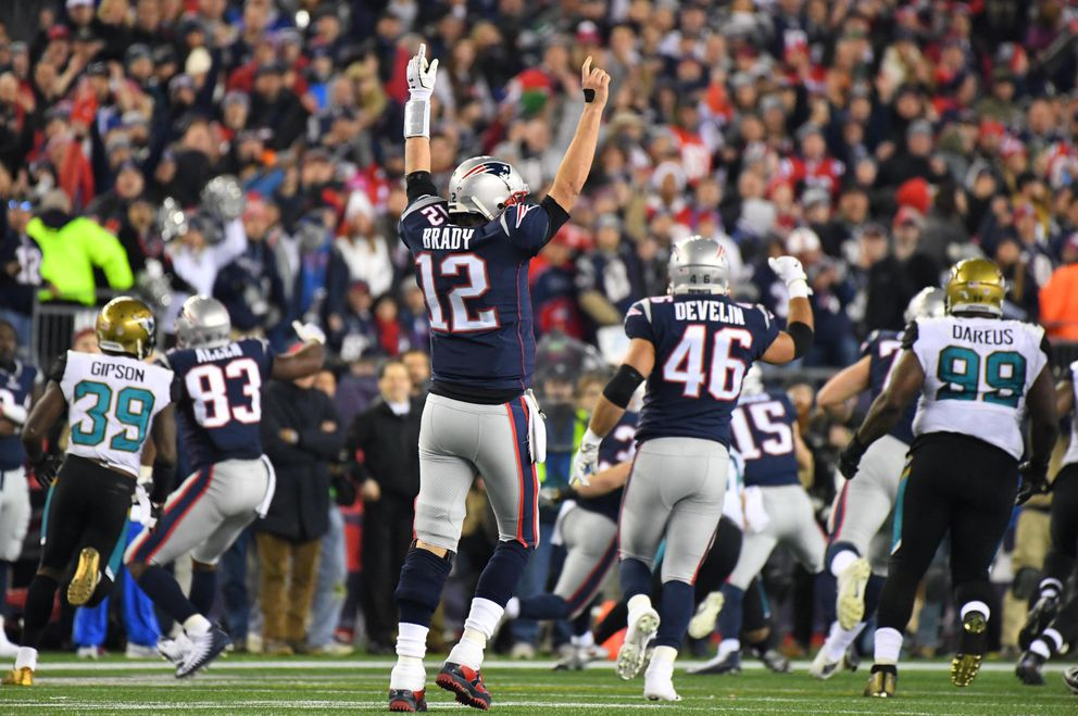 New England Patriots quarterback Tom Brady (12) celebrates after a first down by running back Dion Lewis (33) picks up a first down in the fourth quarter in the AFC Championship Game against the Jacksonville Jaguars at Gillette Stadium on Jan. 21, 2018. (Robert Deutsch / USA TODAY Sports)