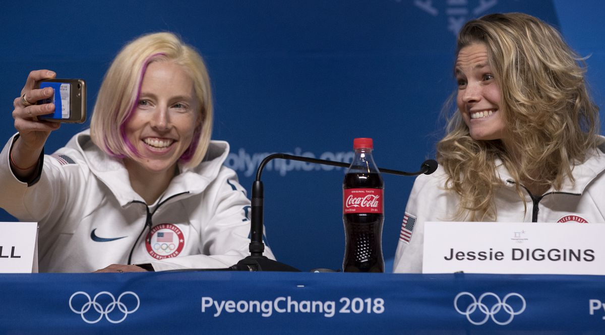 Gold medalists Kikkan Randall, left, and Jessie Diggins take a selfie during a news conference at the Pyeongchang Winter Olympics on Thursday. (Carlos Gonzalez/Minneapolis Star Tribune/TNS)