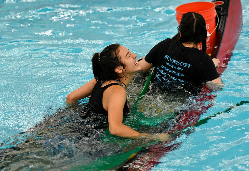Sarah Nunes, from the Latino Student Union team, sinks with her canoe. (Marc Lester / ADN)