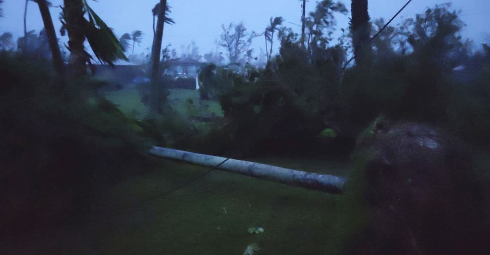 In this photo provided by Glen Hunter, damage from Super Typhoon Yutu is shown outside Hunter's home in Saipan, Commonwealth of the Northern Mariana Islands, Thursday Oct. 25, 2018. As the powerful storm crossed over the island the walls shook in Hunter's concrete home, a tin roof over the garage blew away and howling winds terrified his cats. Maximum sustained winds of 180 mph (290 kph) were recorded around the eye of the storm, which passed over Tinian and Saipan early Thursday local time, the National Weather Service said. (Glen Hunter via AP)